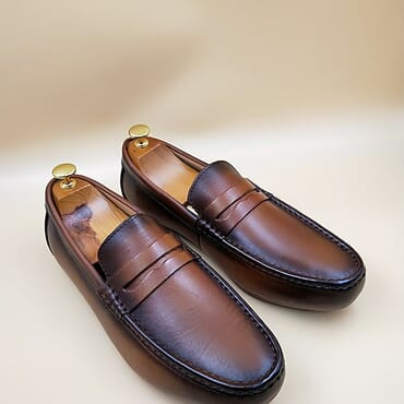 Brown slip on penny loafers