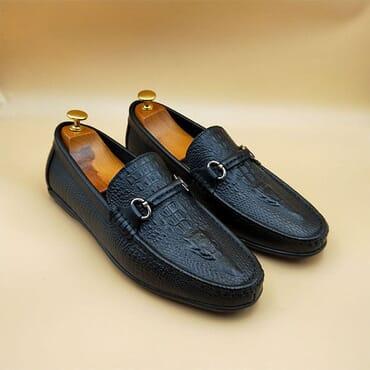 Black Crocs leather Bit loafers.