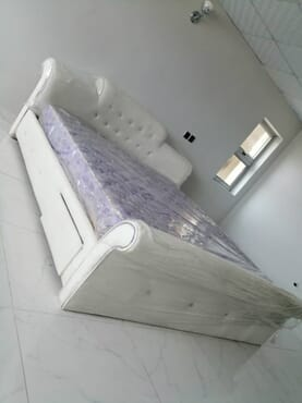 Executive white leather bed