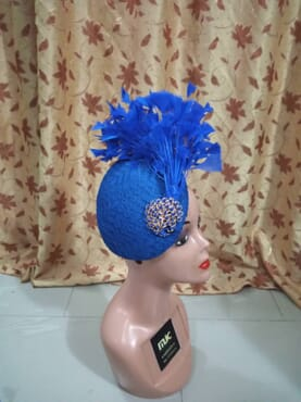 Blue mat hatinator designed with feathers and peacock rose.