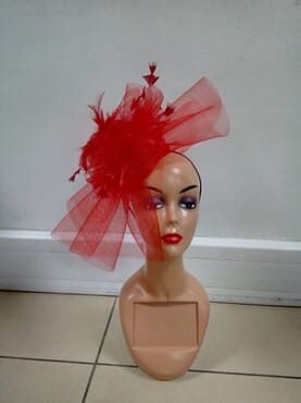 Red fascinator designed with feathers
