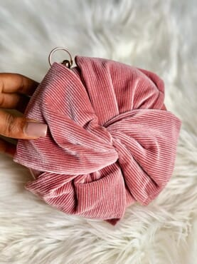 Nissiratti rose clutch purse