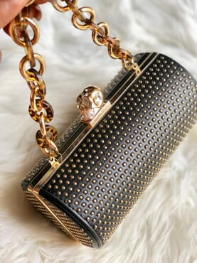 Nissiratti black and gold clutch purse