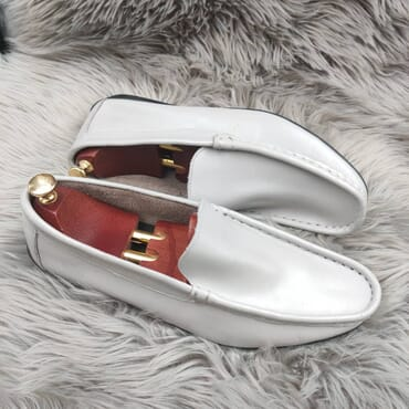 White Slip on Leather Penny Loafers.