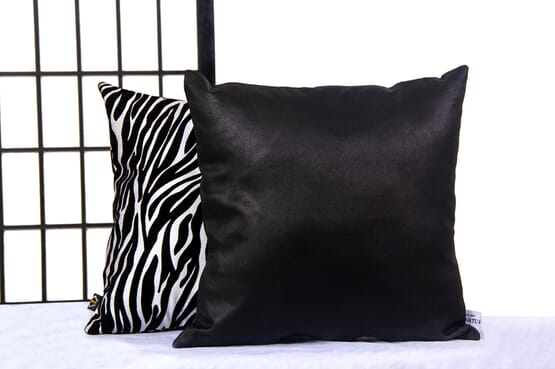 Amata Throw Pillow