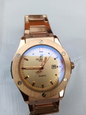 Hublot Rose Gold watch for men.