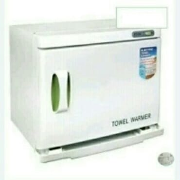 Towels warmer and clippers sterilizer